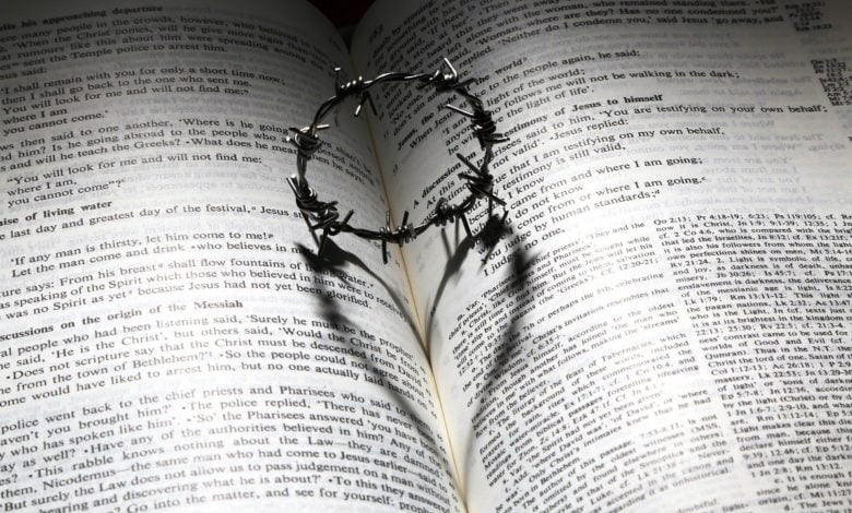 A bible with a shadow resembling love