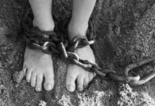 Two feet that are held in captivity showing us how to overcome sin and free us from slavery